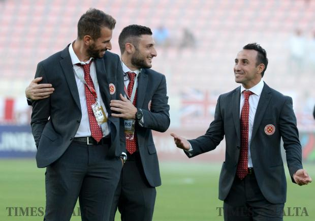 Malta's Michael Mifsud (right) jokes with team players before their qualifying match against England at the National Stadium in Ta'Qali on September 1. Photo: Matthew Mirabelli