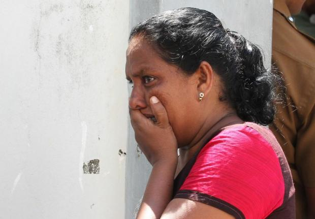Sri Lankans are still trying to come to terms with the horror. Photo: AFP
