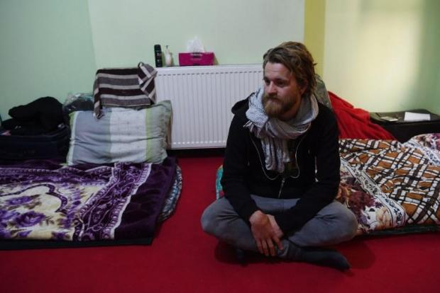 In this photo taken on November 11, Norwegian tourist Jorn Bjorn Augestad, 29, looks on as he talking with Afghan Couchsurfing host Naser Majidi (unseen), 27, at a house in Kabul.
