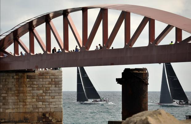 Spectators watch the start of the Middle Sea Race from the breakwater bridge on October 21. Photo: Chris Sant Fournier