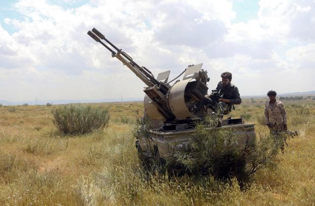 Fighters loyal to Libya's Government of National Accord (GNA) hold a position west of the city of Aziziah, some 60 kilometres southwest of the capital Tripoli.