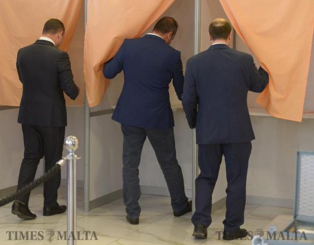 Labour party candidates Owen Bonnici, Dr Chris Cardona and Dr Stefan Zrinzo Azzopardi enter the polling booths before casting their votes to elect the new deputy leader for party affairs in Hamrun on June 10. Photo: Matthew Mirabelli
