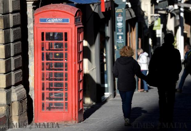 A couple make their way down Merchant Street in Valletta on January 10. Photo: Matthew Mirabelli