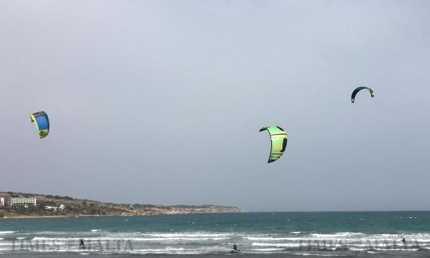 Kites surfers enjoy the strong wind at Ghadira Bay in Mellieha on April 6. Photo: Matthew Mirabelli