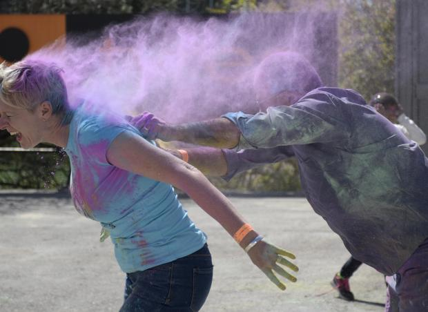 A man throws coloured powder at a woman at the feast of Holi in St Venera on March 31. PHOTO: MARK ZAMMIT CORDINA.