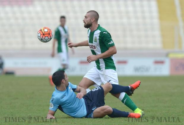 Sliema Wanderers' Mark Scerri (left) and Floriana's Maurizio Vella vie for the ball during their Premier League match at the National Stadium in Ta' Qali on October 1. Photo: Matthew Mirabelli