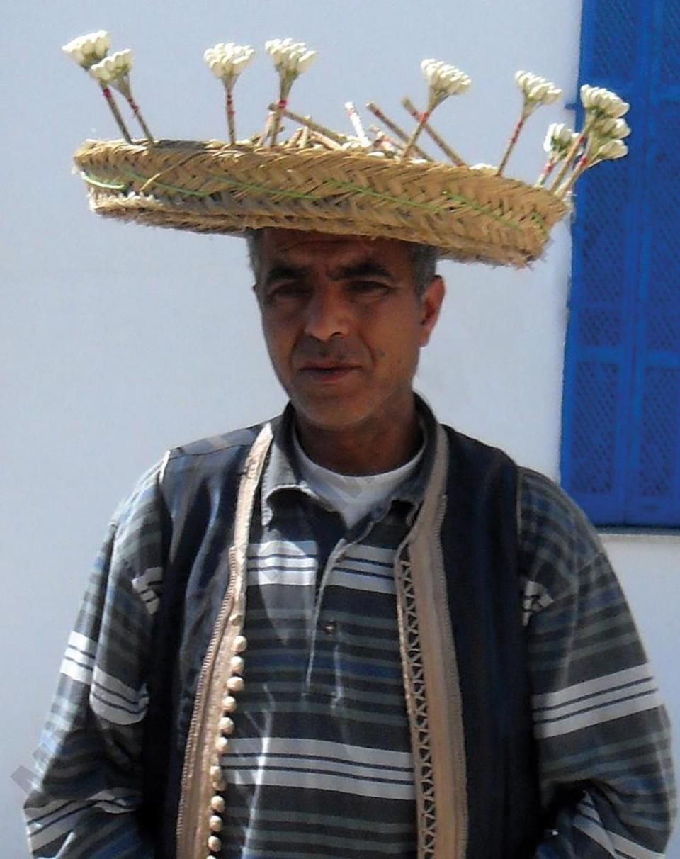 A local man wearing a traditional hat.