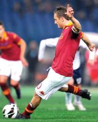 Francesco Totti scores a penalty for Roma.