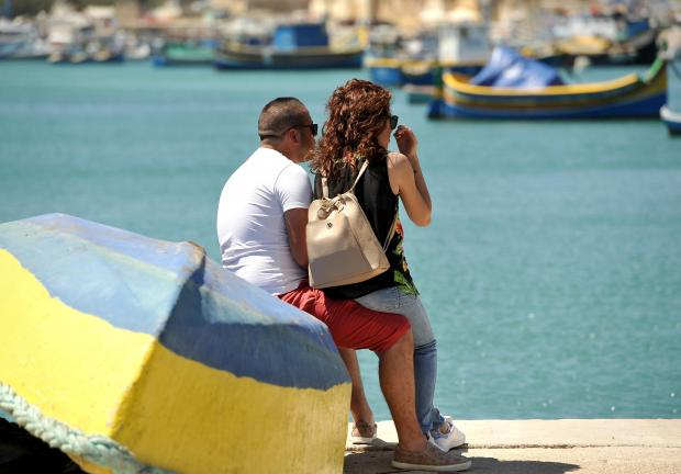 A couple share a moment at Marsaxlokk on May 23. Photo: Chris Sant Fournier
