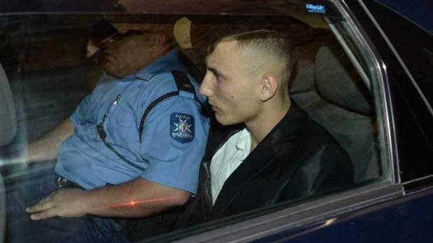 Liam Debono accompanied by a police officer arriving in court on Wednesday.