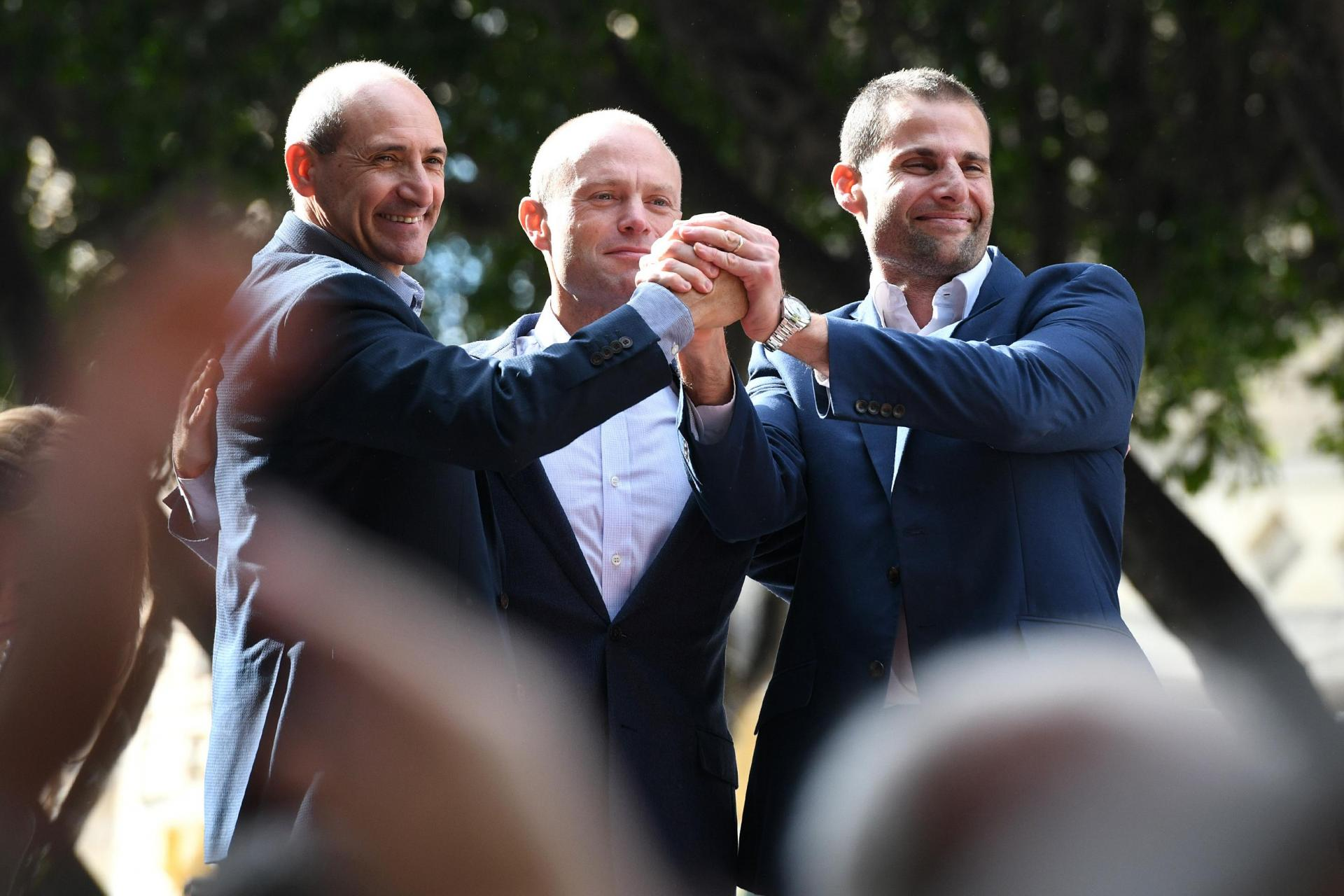 Mr Fearne and Dr Abela stand between Joseph Muscat during a PL event last Saturday.