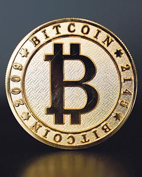 A Bitcoin (virtual currency) coin in an illustration picture taken at La Maison du Bitcoin in Paris, France.