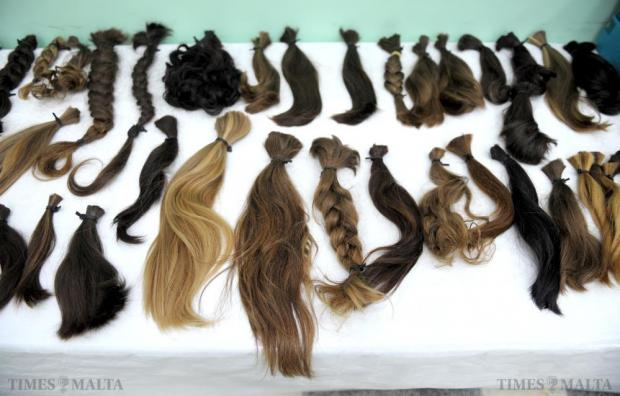 Locks of hair are displayed after being cut during the 'Dare with your hair' event at the Msida Primary School on June 28. The collected hair will be made into wigs for those who have experienced hair loss due to a medical condition. Photo: Matthew Mirabelli