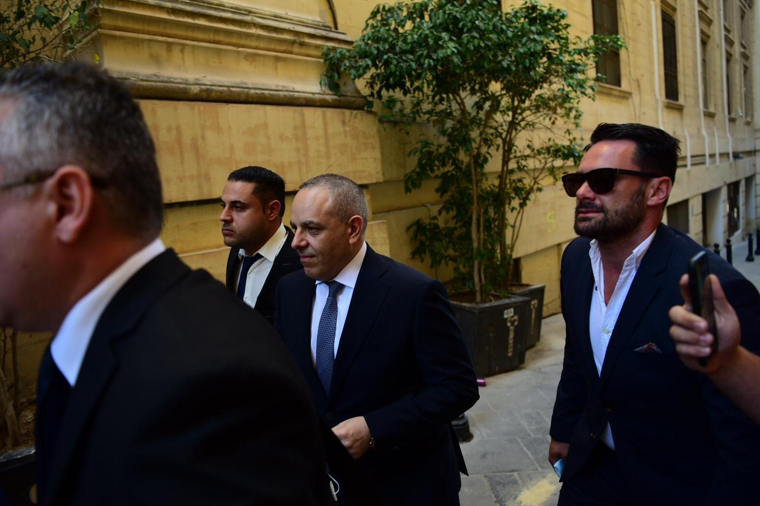 Keith Schembri (centre) entering court on Monday. Photo: Mark Zammit Cordina