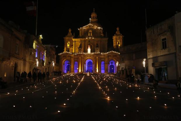 Flaming torches and candles fill the square in front of St Nicholas' Church in Siggiewi on Maundy Thursday on April 2. Photo: Darrin Zammit Lupi