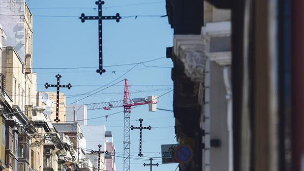 A stark contrast between the cross, which symbolises the crucifixion of Jesus Christ, and tower cranes, considered by many to be the new environmental crosses. Photo: Jonathan Borg