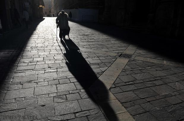A woman walks down Merchant Street, Valletta on February 5. Photo: Chris Sant Fournier