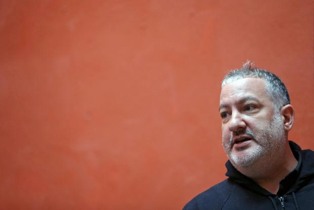 Tunick attends a news conference.