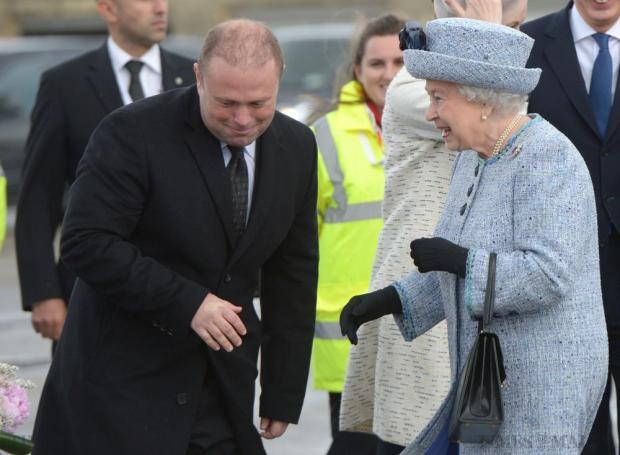 Britain's Queen Elizabeth is greeted by Prime Minister of Malta Joseph Muscat on her arrival in Malta on November 26 for an official state visit. Photo: Matthew Mirabelli