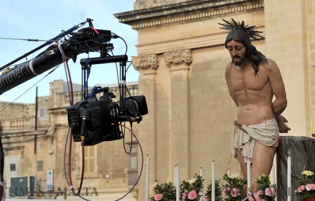 A camera films one of the statues at the Good Friday procession in Zebbug on March 30. Photo: Chris Sant Fournier