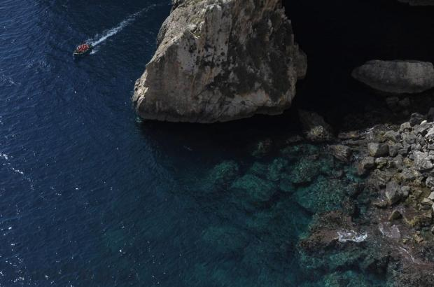 A boat takes tourists around the caves of the Blue Grotto on September 20. Photo: Matthew Mirabelli