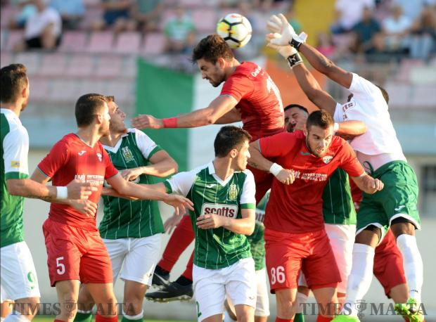 Floriana and Balzan players compete for the ball during their BOV Premiership match at the Centenary Stadium in Ta'Qali on October 14. Photo: Matthew Mirabelli