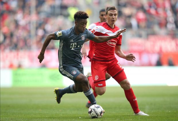 Bayern Munich's Kingsley Coman (left) and Duesseldorf's Marcel Sobottka vie for the ball