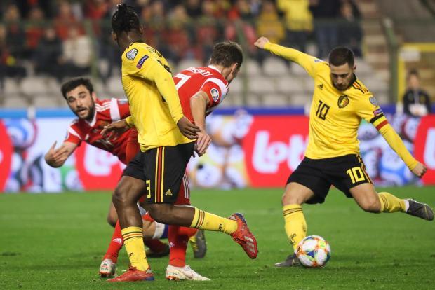 Belgium's forward Eden Hazard (right) shoots and scores a goal.