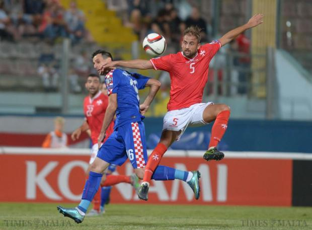 Malta's Andrei Agius (right) competes with Croatia's Nikola Kalinin during their UEFA European Championship Qualifying match against Malta at the National Stadium in Ta'Qali on October 13. Photo: Matthew Mirabelli