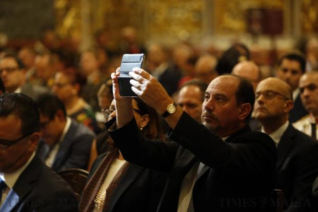 Labour Party whip Godfrey Farrugia takes a picture with his mobile device during High Mass to commemorate Independence Day at St John's Co-Cathedral in Valletta on September 21. Photo: Darrin Zammit Lupi