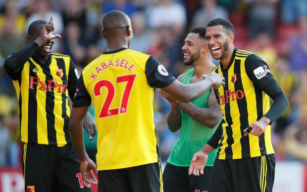 Watford's Etienne Capoue celebrates after the match.