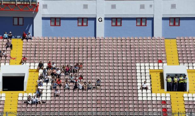 A small number of Valletta supporters wait for the Premier League football match against Hibernians to begin at the National Stadium in Ta' Qali on May 9. Photo: Darrin Zammit Lupi