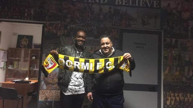 Romeo Romau with Qormi president Victor Camilleri.