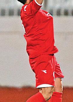 Ecstatic... Michael Mifsud celebrates his record-breaking goal in Malta's 2-1 defeat to Finland. Photo: Paul Zammit Cutajar