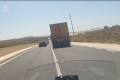 Watch: Truck in dangerous manouevre, road grating caves in....