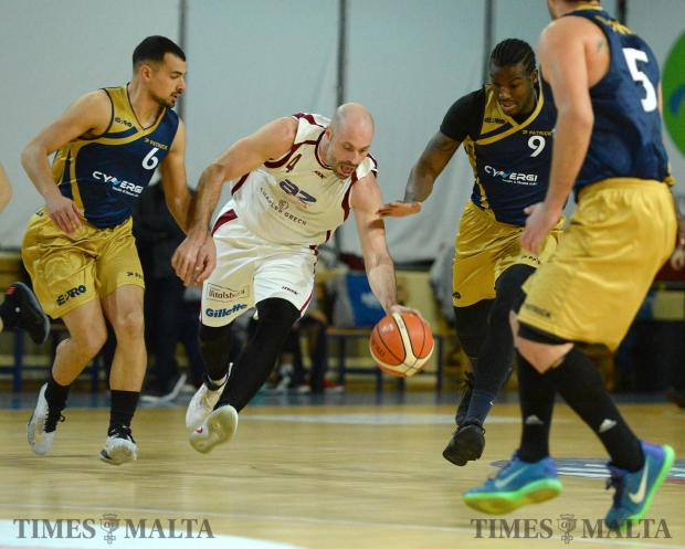 Gzira Athleta's Michael Naudi (centre) tries to find his way through the Depiro defence on January 15 at the Basketball Pavilion in Ta'Qali. Photo: Matthew Mirabelli