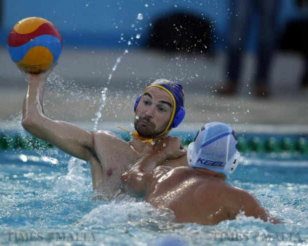 San Giljan's Clint Mercieca (left) fends off a challenge by Sliema's Mark Meli during the Premier Division Winter League decider at the National Pool in Tal-Qroqq on April 27. Photo: Darrin Zammit Lupi