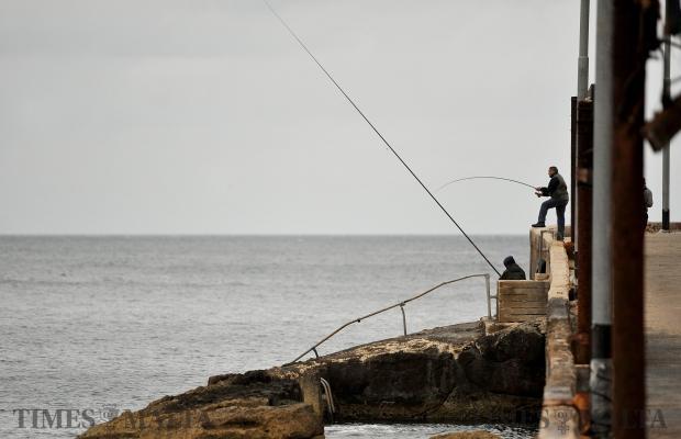 Two men cast their fishing lines into Marsamxett Harbour on February 22. Photo: Chris Sant Fournier