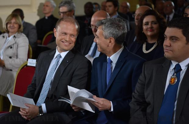 Prime Minister Joseph Muscat and Opposition Leader Simon Busuttil chat during the Sette Gunio ceremony in the first pictures seen next to each other after the general elections in Valletta on June 6. Photo: Mark Zammit Cordina