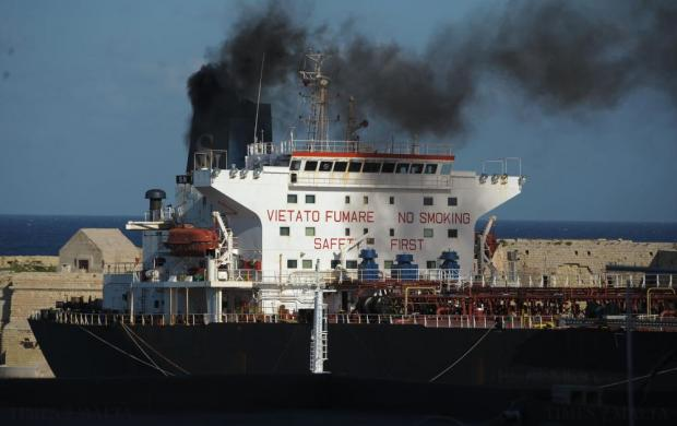 A ship bellows black smoke while berthed in the Grand Harbour on November 28. Photo: Matthew Mirabelli