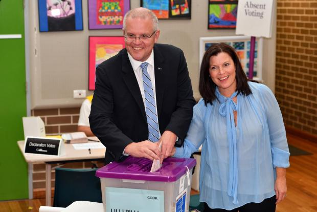 Scott Morisson and his wife casting their votes. Photo: AFP