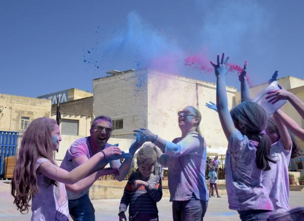 Adults and children throw powder into the air at the feast of Holi in St Venera on March 31. PHOTO: MARK ZAMMIT CORDINA.
