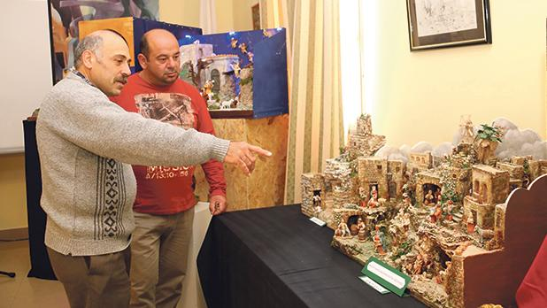 Picture shows Friends of the Crib Society (Nadur) president Anthony Sammut (left) explaining a detail to one of the visitors. Photos: Charles Spiteri