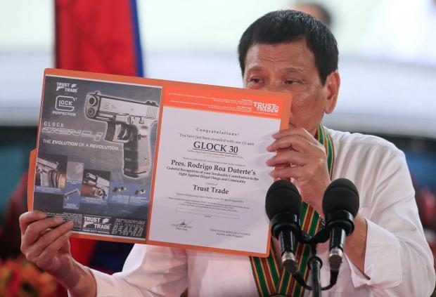 Philippine president to order review of defense pact with US