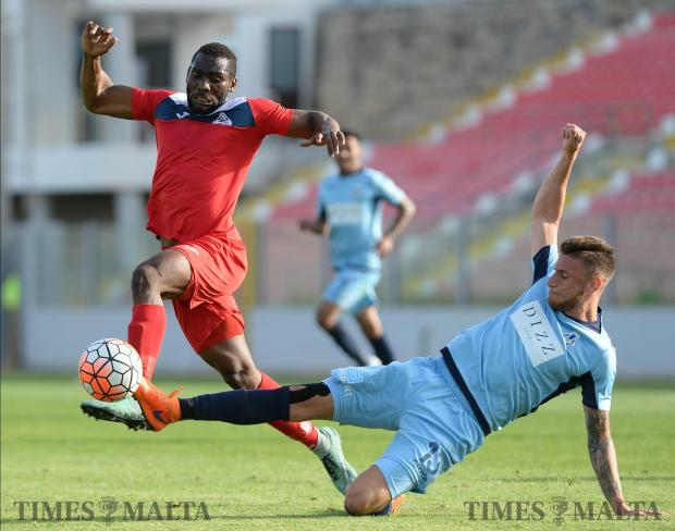 Sliema' Leonardo Incorvaia (right), slides in to steal the ball from Pembroke's Emmanuel Naatey during their BOV premiership match at the Hibernians Stadium in Kordin on April 29. Photo: Matthew Mirabelli