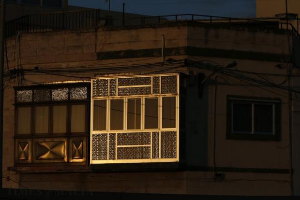 The setting sun is reflected off aluminium balconies in Marsa on November 13. Photo: Darrin Zammit Lupi