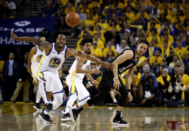 Andre Iguodala (left) of the Golden State Warriors steals the ball from Landry Shamet of the LA Clippers.