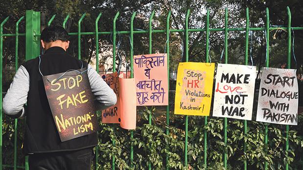 An Indian demonstrator installs placards during an anti-war demonstration called by pacifist organisations in New Delhi on March 4. Photo: Dominique Faget/AFP