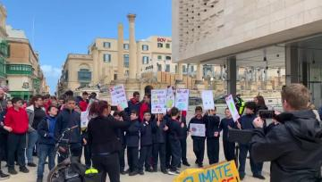 Watch: 'I wish you would listen'... young activists march for climate change | Young activists outside parliament. Video: Ivan Martin