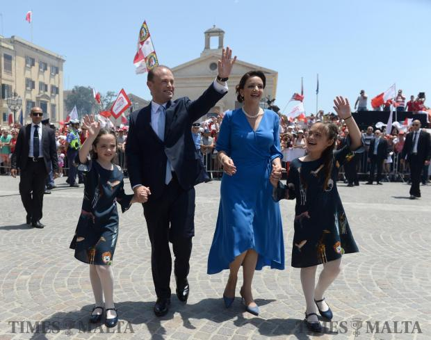 Joseph Muscat, accompanied by his wife, Michelle Muscat and two daughters, make their way into the Auberge de Castille after being sworn in as Prime Minister of Malta at the Palace of the Grand Master, Valletta on June 05. Photo: Matthew Mirabelli